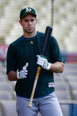 Bobby Crosby Holding a Bat in Batting Practice Jersey.jpg