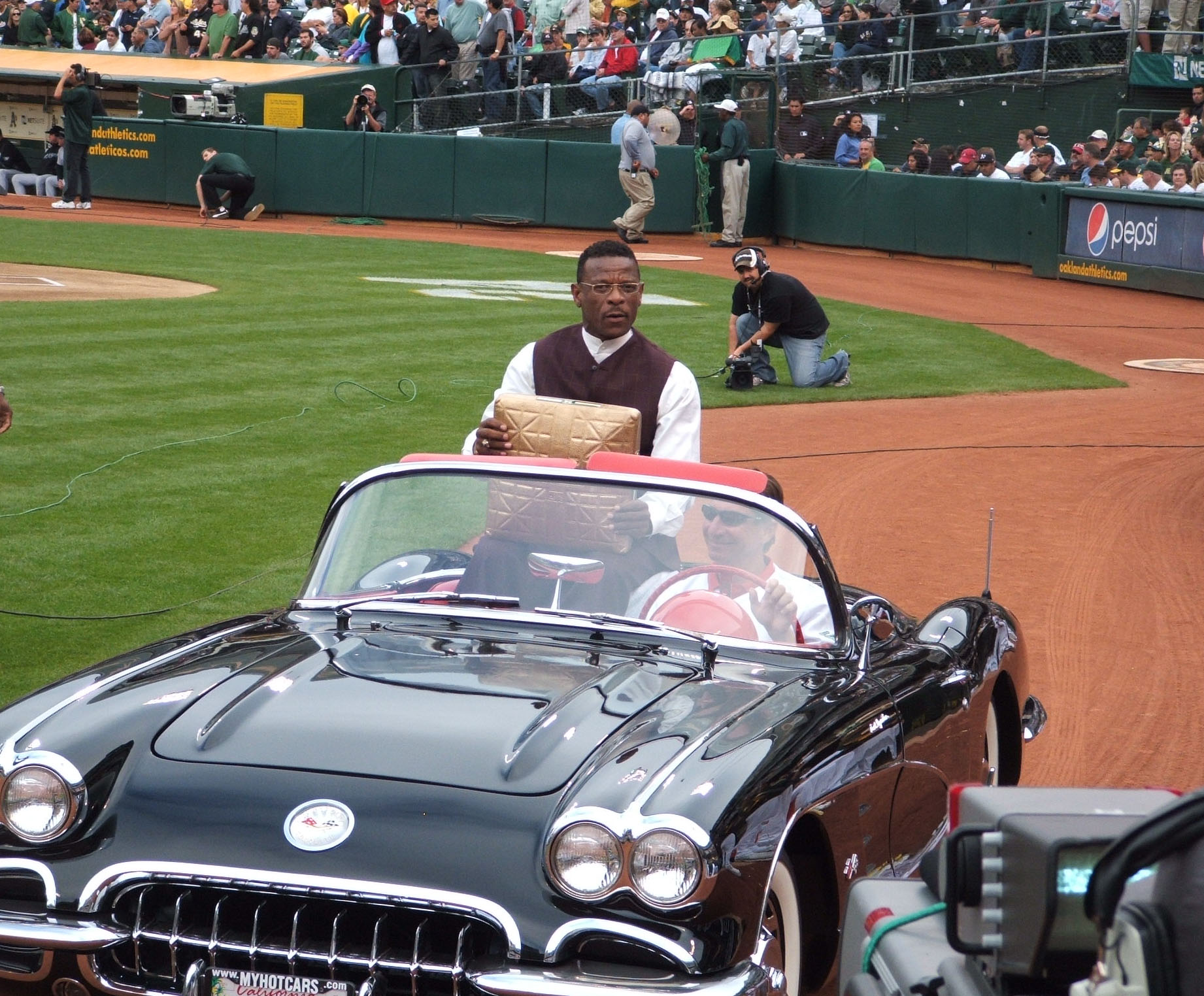 Rickey riding in car with gold base - cropped.jpg
