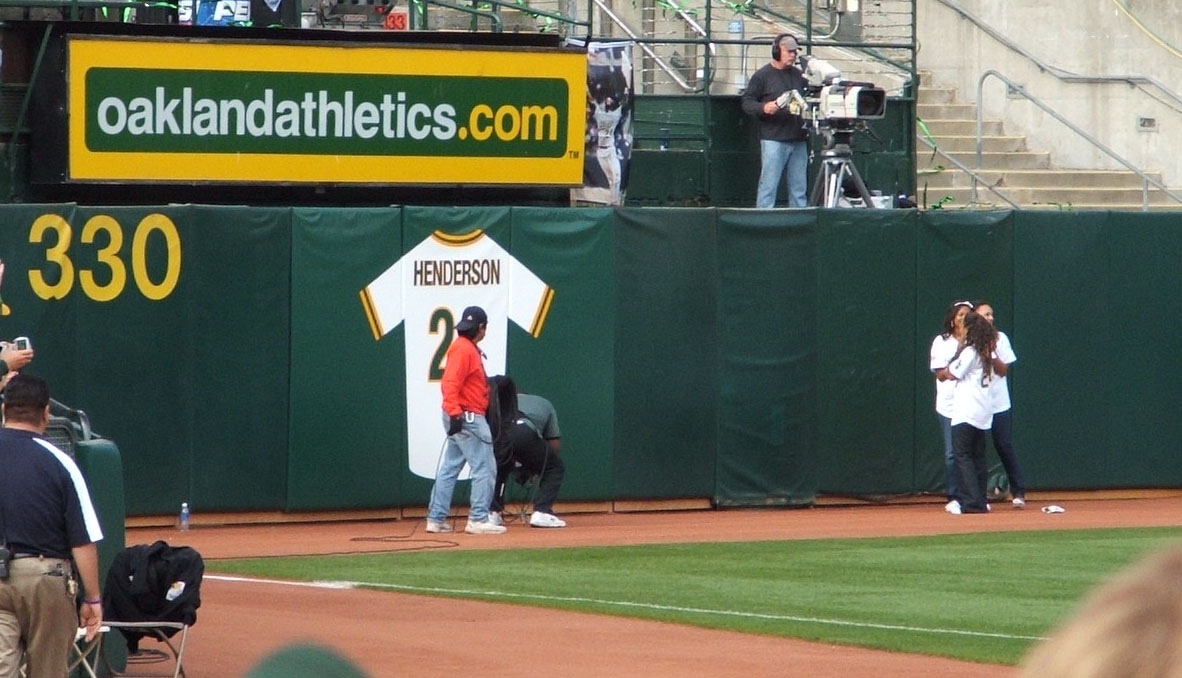 Rickey's daughters unveiling his jersey on left field fence.jpg