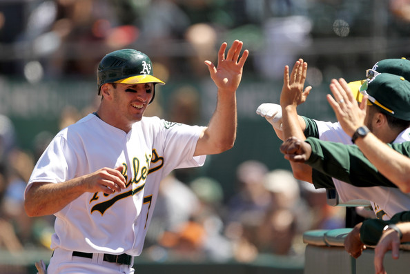Adam Rosales being congratulated for scoring against the Giants.jpg